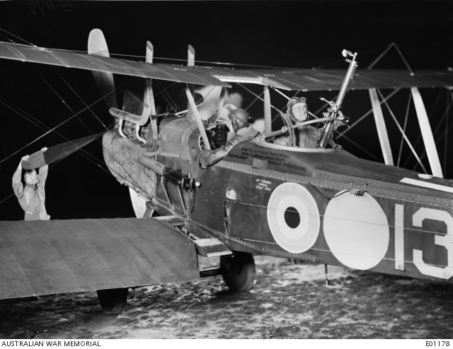 Harold Taylor, sat in the rear of an RAF RE-8 aircraft;  a two-seater biplane with forward-firing and rear-firing  machine guns, mostly used in artillery observation
